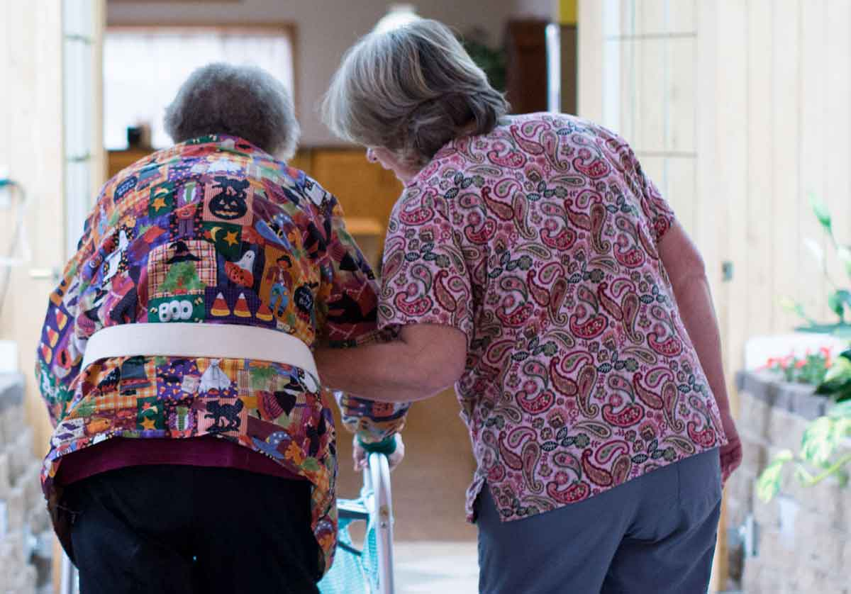 Rose Haven Assisted Living resident walking with nurse